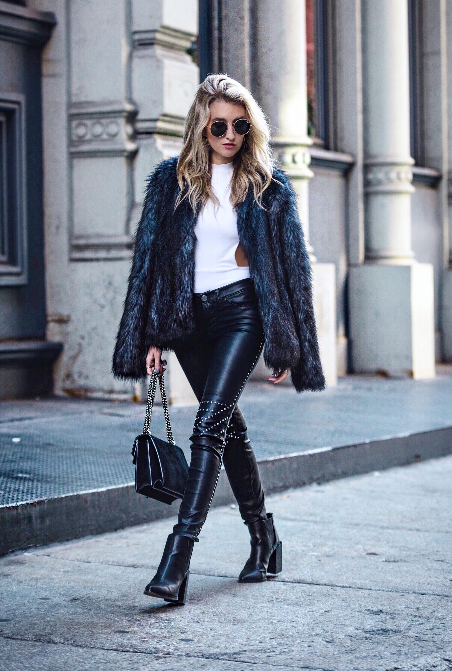 faux leather studded pants and fur coat